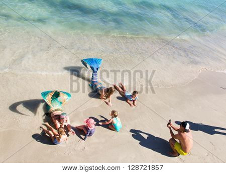 COOGEE,WA,AUSTRALIA-APRIL 3,2016: Live interactive mermaids entertainers beached in costume at the Coogee Beach Festival during a meet and greet with children in Coogee, Western Australia.