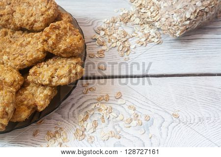 Proper nutrition. Cottage cheese and cereal biscuits on a wooden background