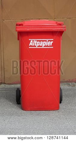 WIEN AUSTRIA - CIRCA APRIL 2016: Altpapier (meaning Old paper or waste paper) red waste containers aka Litter bin garbage bin trash bin or waste bin