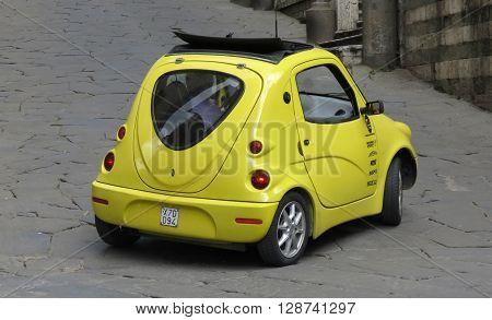 Yellow Neuspeed Car