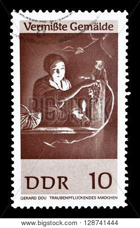 GERMAN DEMOCRATIC REPUBLIC - CIRCA 1967 : Cancelled postage stamp printed by German Democratic Republic, that shows painting Girl Gathering Grapes by Gerard Dou.