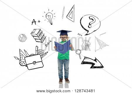 childhood, school, education, learning and people concept - happy boy in bachelor hat or mortarboard and eyeglasses reading book with doodles