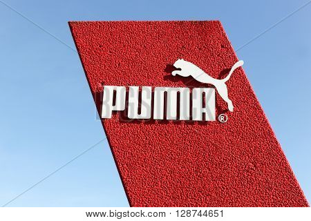 Skanderborg, Denmark - May 5, 2016: Puma logo on a wall. Puma is a major german multinational company that produces athletic and casual footwear, as well as sportswear, headquartered in Herzogenaurach in Germany