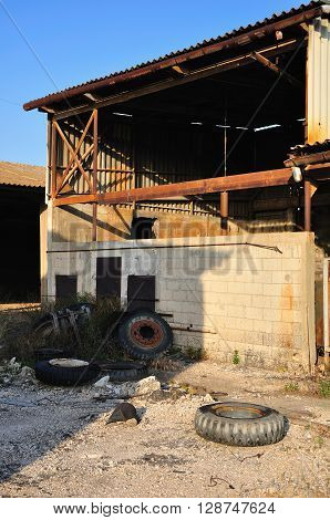 Ruined ramshackle hangar in abandoned industrial  zone.