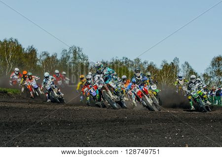 Miasskoe Russia - May 02 2016: group of riders motorcycle rides on dusty track during Cup of Urals motocross