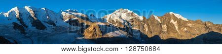 Panorama view of the Bernina massive including Piz Bernina Piz Palu Piz Bellavista and the glacier from Diavolezza in the morning sunshine Eastern Alps in Canton of Grisons Switzerland.