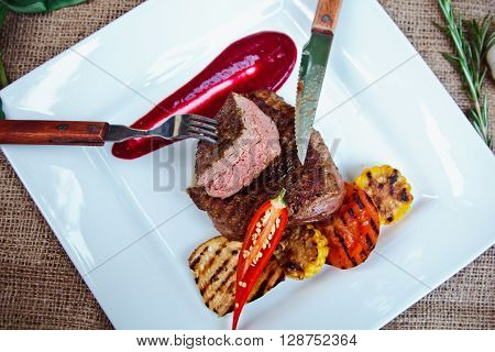 Beautiful Grilled Steak Of Veal With Berry Sauce And Spices