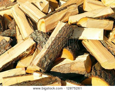 Pile of old firewood background