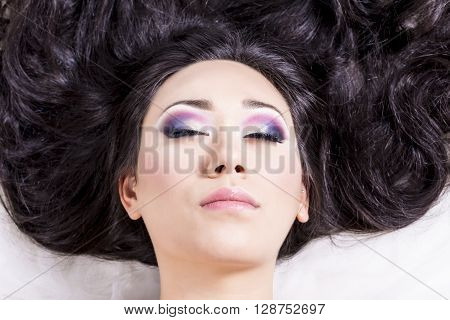 Front View Of Model Portrait With Black Hair Over White