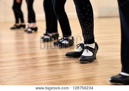 Close Up Of Feet In Children's Tap Dancing Class
