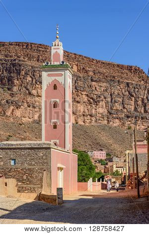 A mosque on a narrow street in remote village of Amtoudi in Morocco.
