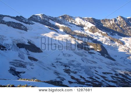 big mountains with snow ice and stones poster
