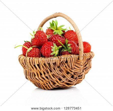Strawberries in wicker basket on white background