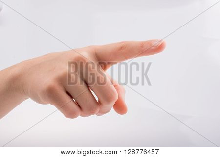 A hand is pointing on a white background