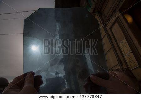 Watching eclipse seen through the roentgen. Shot in St.Petersburg Russia March 202015.