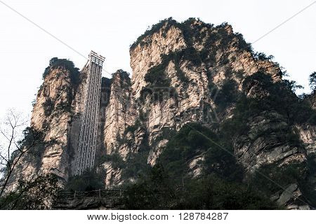 ZHANGJIAJIE CHINA - FEB 29 2016 : Bailong Elevator is a glass elevator built onto the side of a huge cliff in the Wulingyuan area of Zhangjiajie China that is 1070 feet (330 m) high
