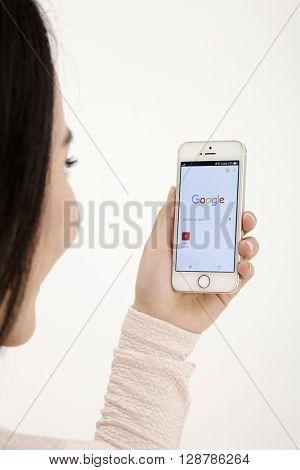 KUALA LUMPUR, MALAYSIA - 8th Augst 2015, Woman Using Google Web Search on her Smart Phone.