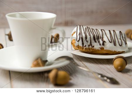 Cup of coffee and sweet buns on brown