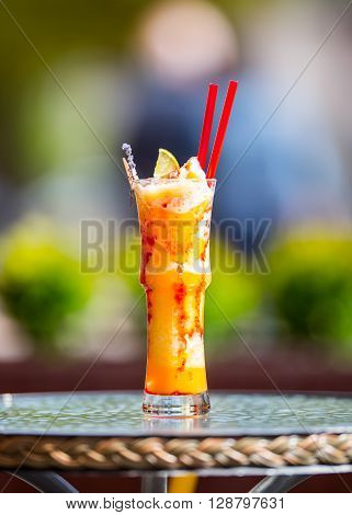 Fresh cocktail with orange limet mint and ice. Alcoholic non-alcoholic drink-beverage.
