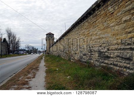 JOLIET, ILLINOIS / UNITED STATES - NOVEMBER 7, 2015: The exterior wall of the old Illinois State Penitentiary along Collins Street in Joliet, Illinois.