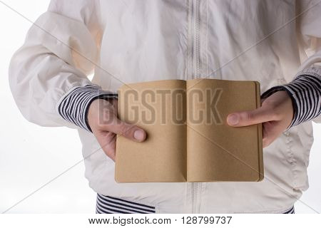 Hand Holding A Notebook