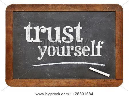 Trust yourself  - white chalk text on a vintage slate blackboard