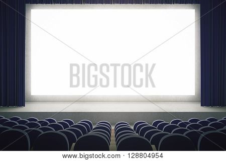 Movie theater with blank mock up screen. Cinema auditorium with white copy space screen. Rows of seats in cinema theater. Mock up 3D Rendering