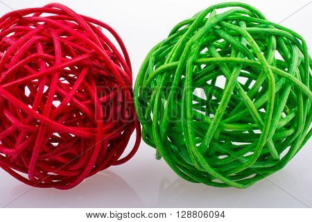 red and green wooden balls on a white background