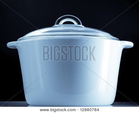 ceramic  saucepan on a black background