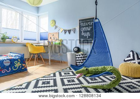 Fun child room arranged in scandinavian style with work space and fun accessories