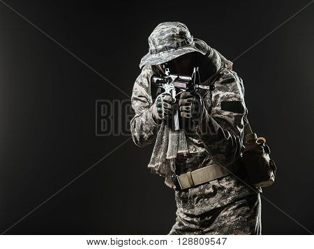 Special Forces Soldier Man With Machine Gun On A  Dark Background