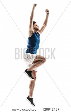 I won this competition. Full length portrait of attractive young sportsman raising his arms wile celebrating success. Man is standing and looking up happily. Isolated