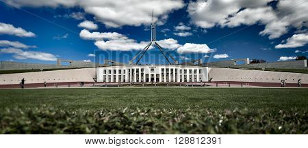 Parliament House, Canberra, Australia.  On a sunny day taken from a low POV, with a strong blue cloudy sky in the background.