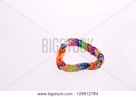 Color rubber hairclips connected on a white background