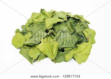 Dried kaffir lime leaves on a white background