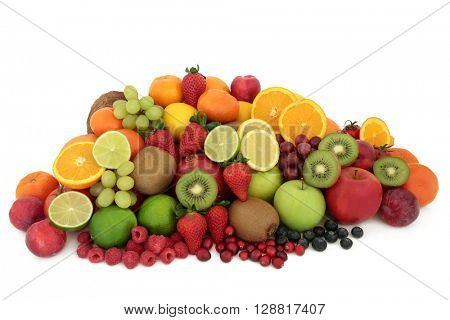 Large healthy fresh fruit selection over white background. High in antioxidants, vitamins, anthocyanins and dietary fiber.