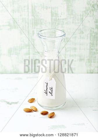 Organic almond milk in  a glass bottle