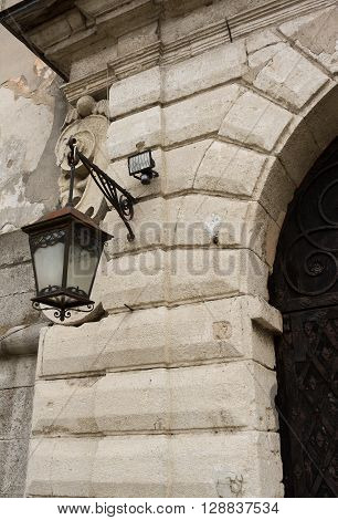 Vintage lamp on the wall. The historic center of the city. Western Ukraine