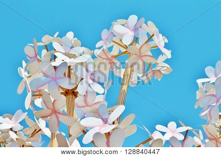 Homemade Paper Flowers On A Background Of Bright Blue Sky