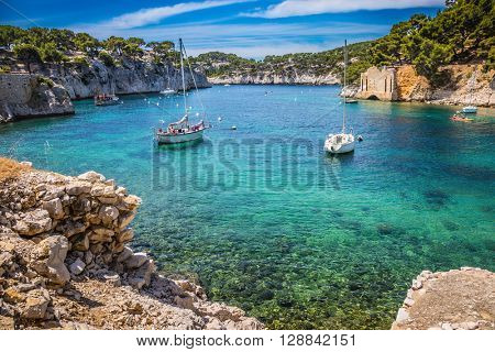 National park of Calanques in Provence. The picturesque gulf with turquoise water at coast of the Mediterranean Sea. Graceful sailing yachts in the sea fjord