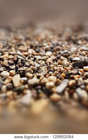 A photo background with different brown stones. ** Note: Shallow depth of field