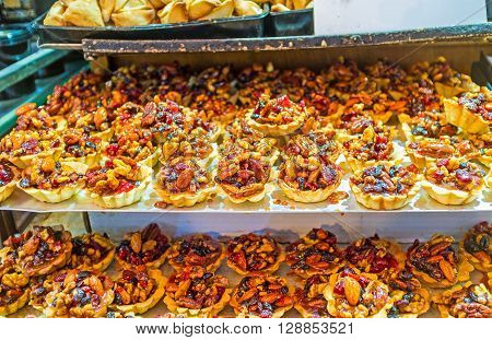The pastry baskets with the dried fruits nuts and honey are the popular sweets in Jerusalem's candy stores Israel.