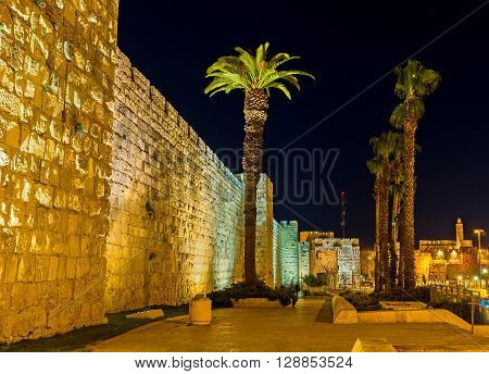 The empty street leading along the medieval ramparts to the Jaffa Gate of Jerusalem Israel.