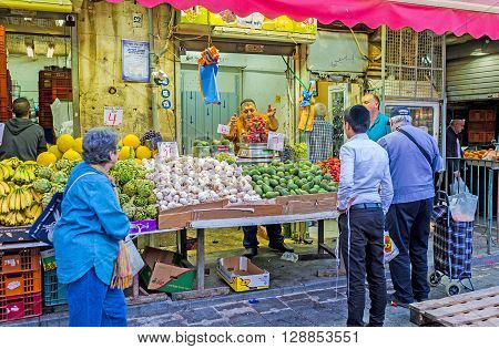 JERUSALEM ISRAEL - FEBRUARY 17 2016: The stall in Mahane Yehuda market with the fresh vegetables and fruits on February 17 in Jerusalem.