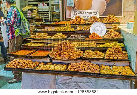 JERUSALEM ISRAEL - FEBRUARY 17 2016: The stalls of Mahane Yehuda market offer baklava fingers lokum and other local sweets on February 17 in Jerusalem.