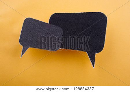 Black dialogue boxes on a yellow background
