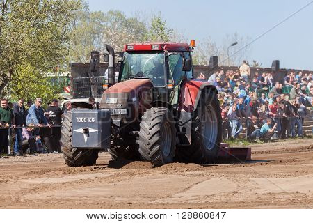 GRIMMEN/ GERMANY - MAY 5: german case puma cvx 150 tractor drives on track on a motortechnic festival on may 5 2016 in grimmen / Germany.
