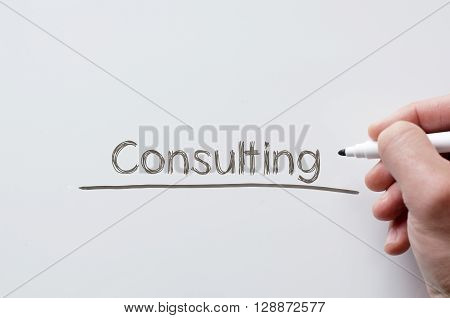 Human hand writing consulting on whiteboard .