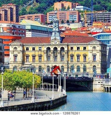 Bilbao city downtown with a Nevion River, Bridge and promenade poster