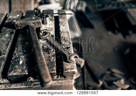 Industrial Tools In Old Factory, Metal Table With Mechanic Wrench And Hammer